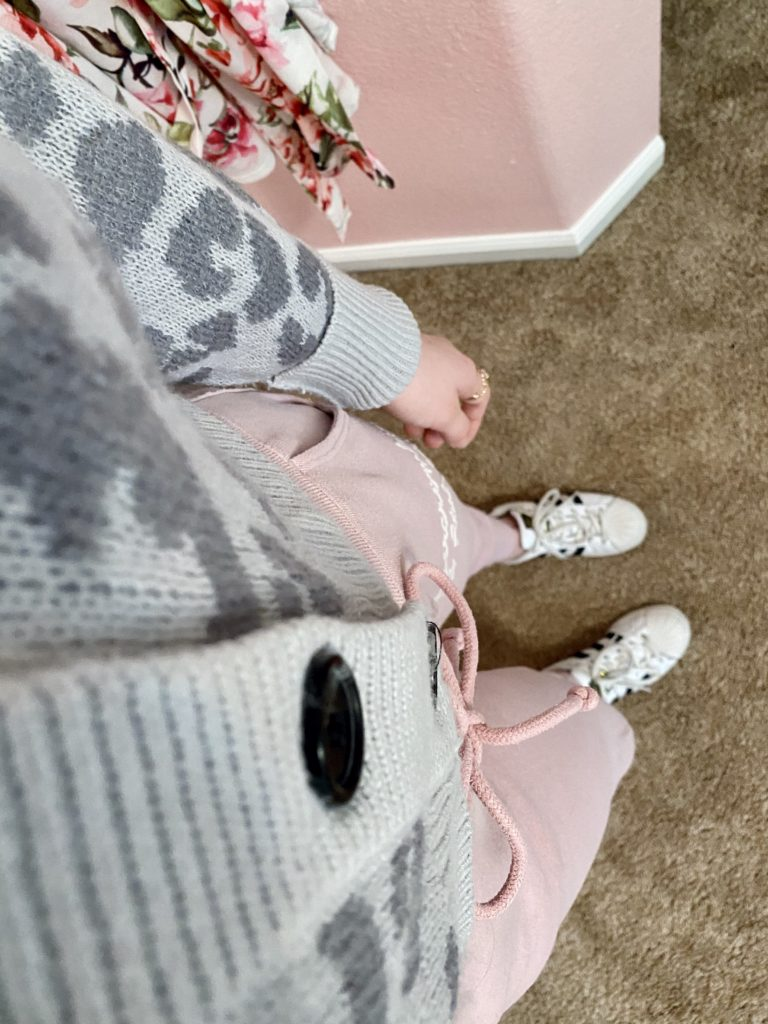 comfy essentials, gray cheetah leopard print button front cropped cardigan sweater with pink abercrombie and fitch logo sweatpant joggers, and white adidas superstar sneakers, and a gold ring stack for a casual and cozy look