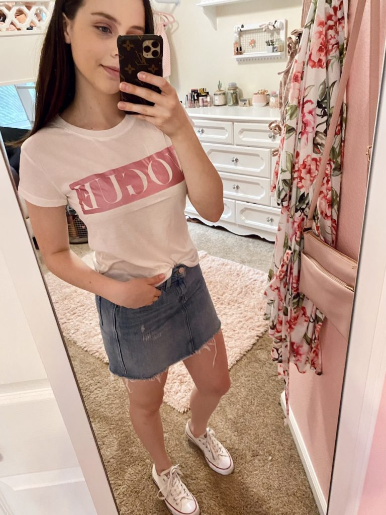 thredup review, levi's distressed and frayed denim mini skirt with silver hardware found at the world's largest online thrift store, thredup, styled with a pink and white metalic vogue lettered tee shirt and white low top converse sneakers with a pearl hair clip