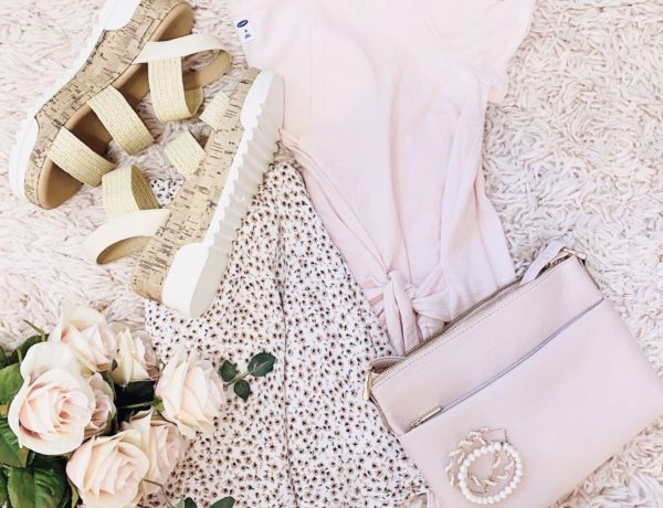 pink floral skirt outfit ideas, pink and white ditsy floral skirt styled with a pink v-neck wrap top, straw steve madden espadrille dupes, a pearl bracelet, pearl hoops, pink purse, and gold rings