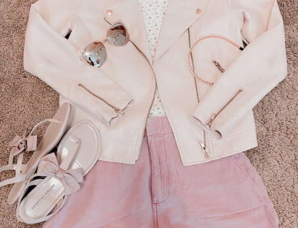 pink pleather jacket with pink shorts, pink bow, ted baker sandal dupes, a white floral tee shirt with pink cat eye sunglasses, and a pearl headband