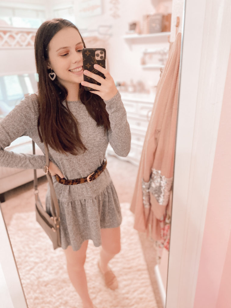 """answering the question, """"is forever 21 closing"""" + a try on haul, first outfit, gray marled, ruffle hem, peplum, dress with long sleeves styled with a leopard and gold belt, a taupe shoulder bag, pink quilted slip on sneakers, and pearl heart earrings"""