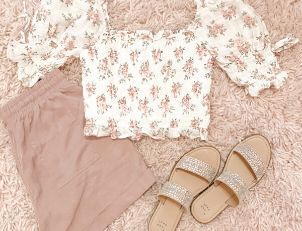 shabby chic outfit with white and pink vintage floral top, pink tie waist shorts, and embellished sandals