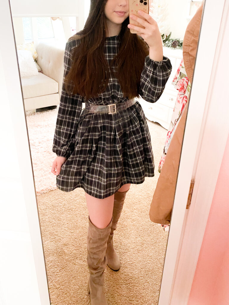 christmas outfit idea with knee high boots and plaid dress