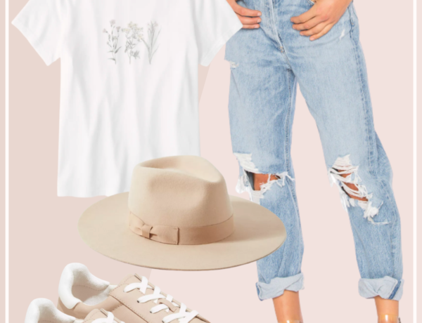 feminine spring outfit with high waisted distressed jeans and blush pink sneakers with a floral print tee shirt and light tan fedora hat