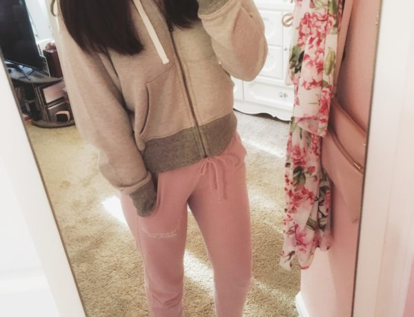 the best option for comfy outfits to wear at home, natural tone zip up and cropped sweatshirt styled with pink abercrombie and fitch logo sweatpants, white low top converse, and a gold star necklace for a cozy look