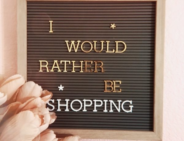 "what to buy from the macy's sale, letterboard with wording ""i would rather be shopping"""