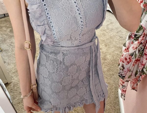 girly outfit ideas, light sky blue lace tie dress with gold and light blush pink purse, rose gold rings, and cream wrap over front mini heels