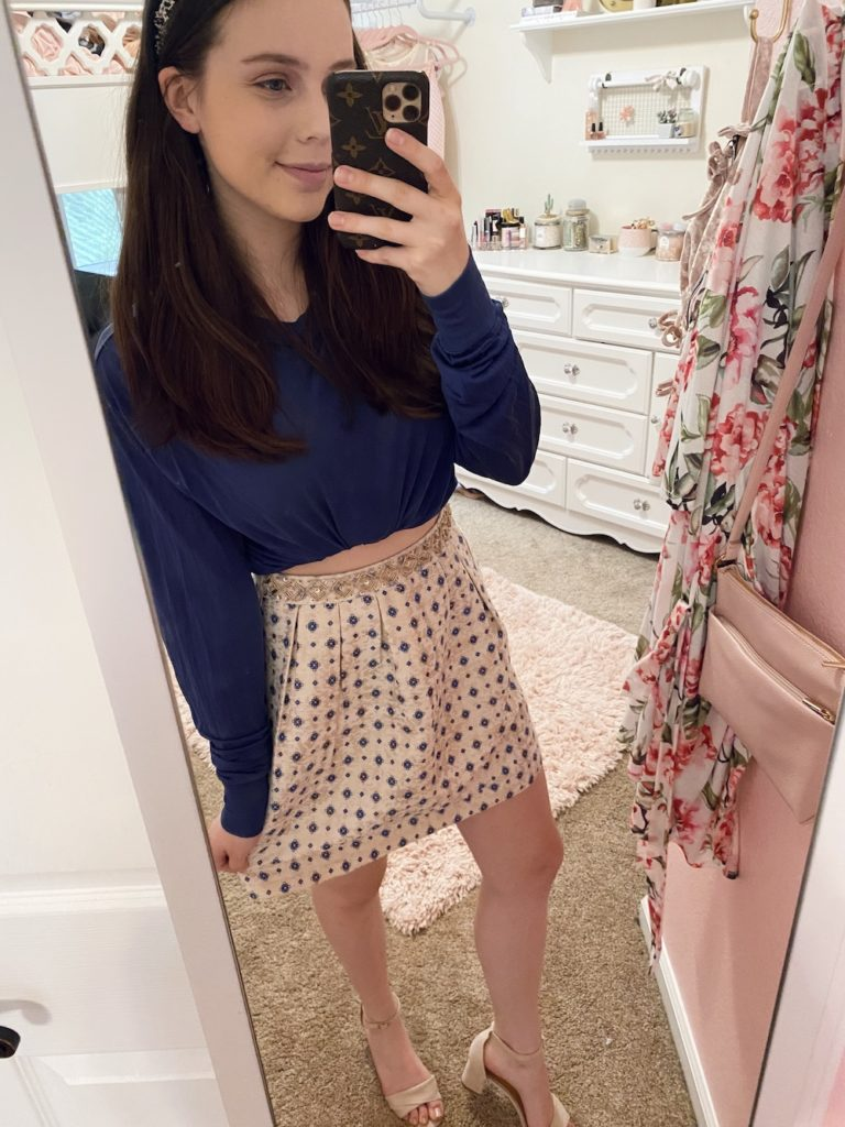 thredup review, navy blue long sleeve bubble crop top with a gold, navy blue, and cream diamond pattern gold waist skater structured skirt, black tweed headband, and cream wrap over front ankle buckle mini heels from amazon