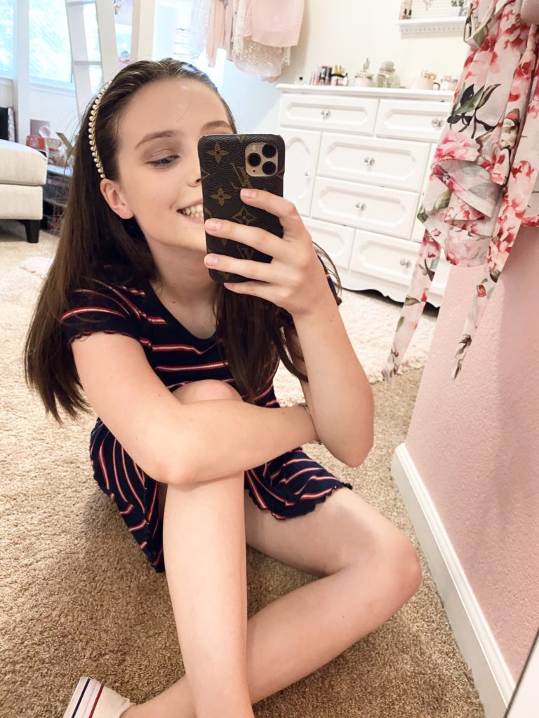 4th of july outfit ideas   red, navy blue, and white striped tee shirt dress with lettuce edges worn with low top white converse and pearl headband